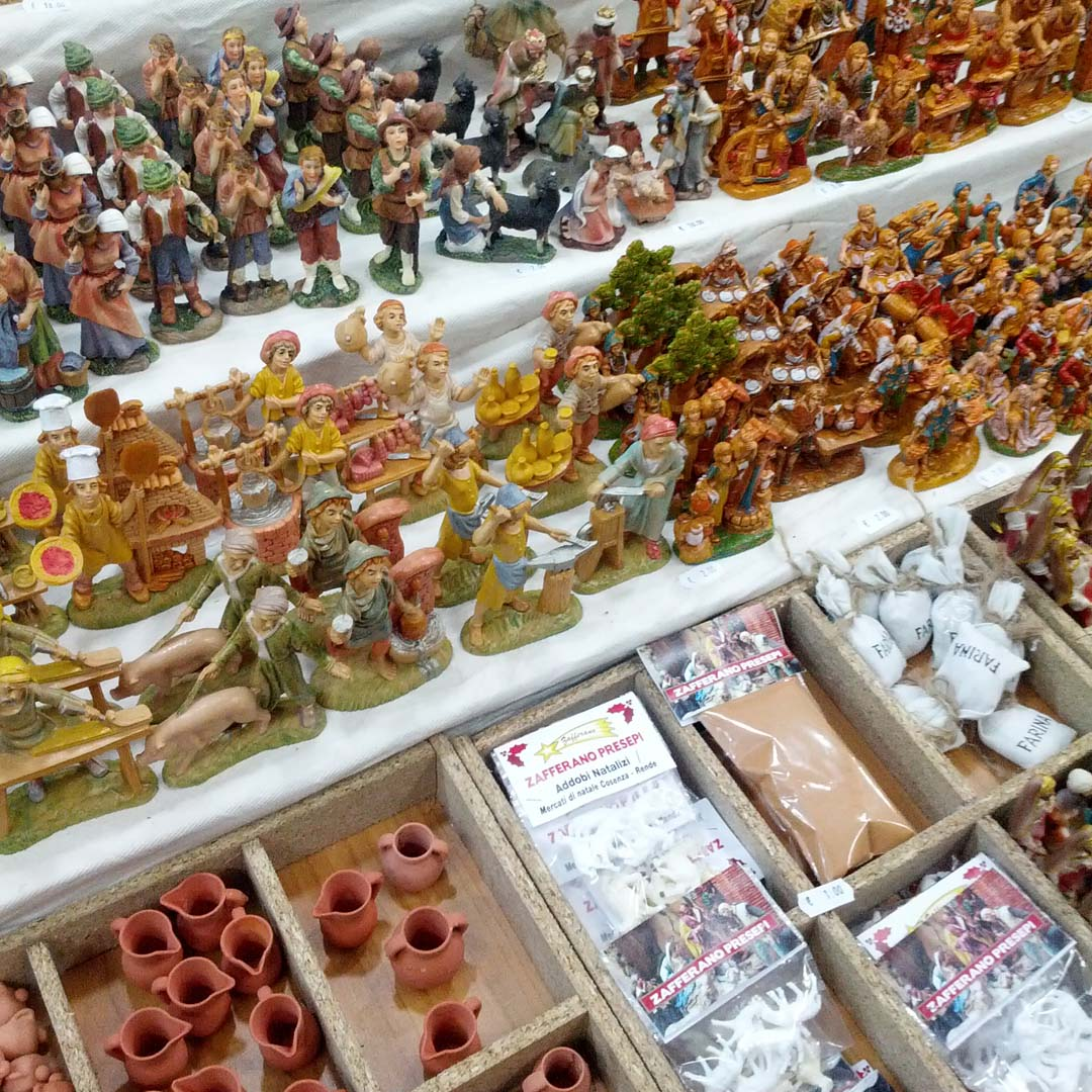 Christmas market stand selling nativity pieces.